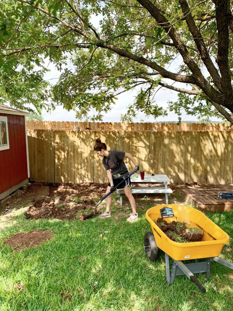 woman digging in a backyard