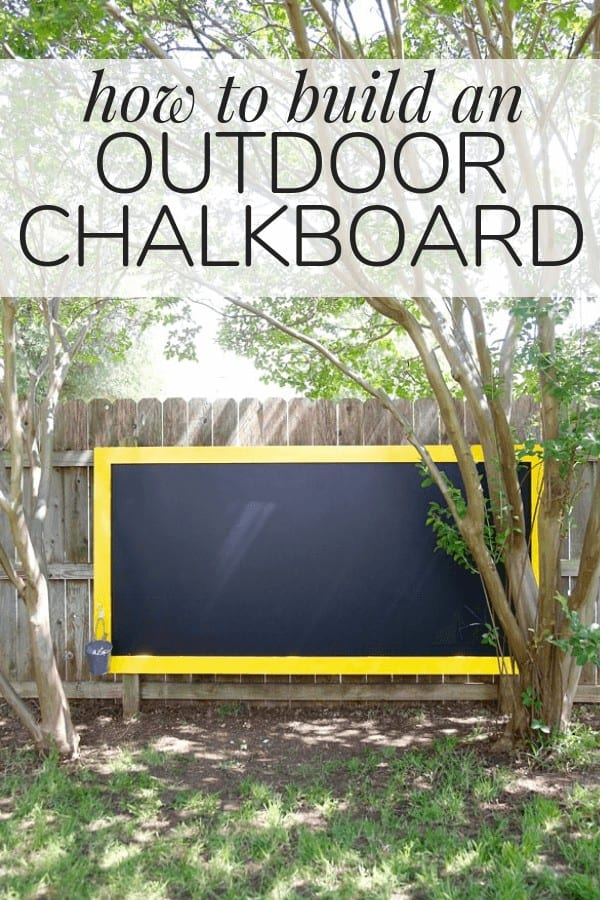 """Large chalkboard hanging on a fence with text overlay - """"how to build an outdoor chalkboard"""""""