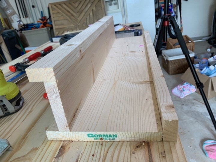 close up image of wall shelf with hooks prior to being painted