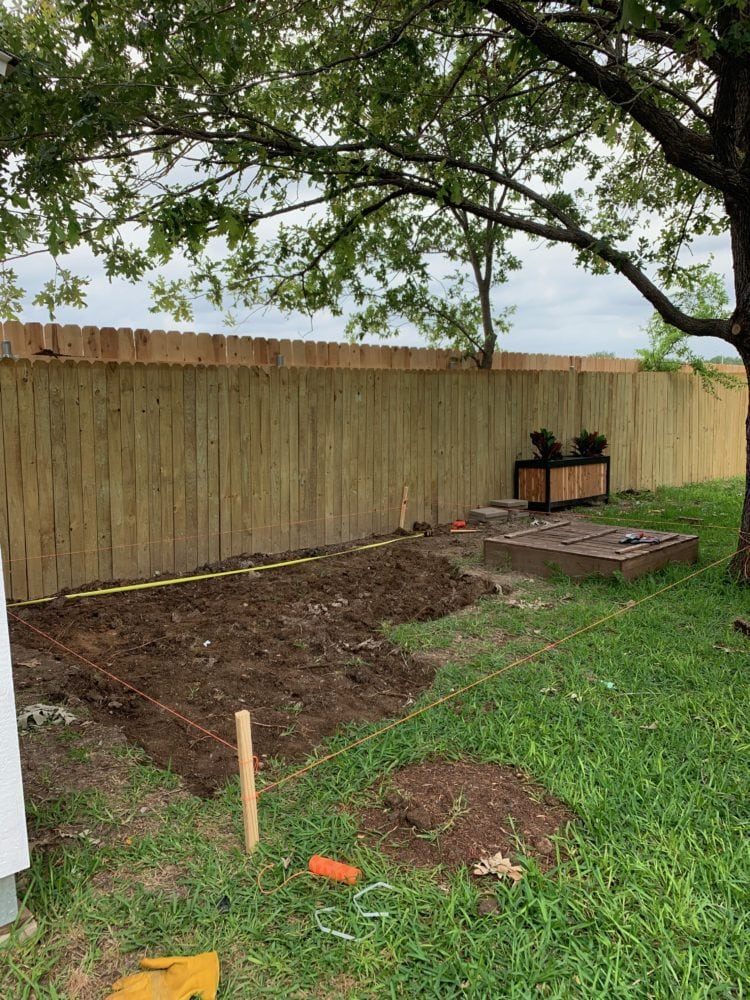 beginning of pea gravel patio - dirt dug out of ground
