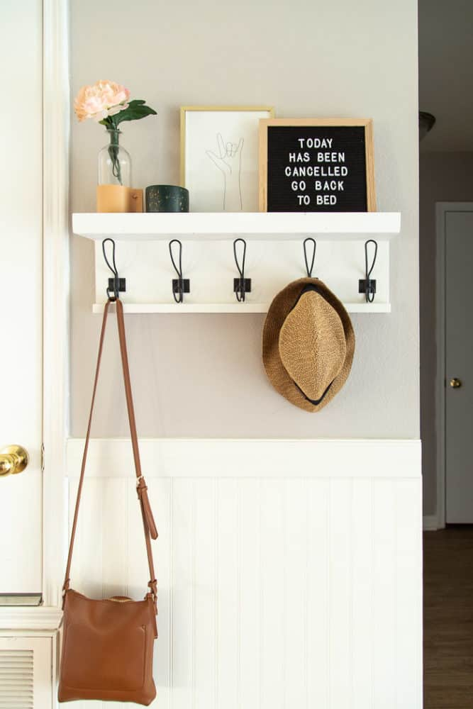 entry with wall shelf and hooks