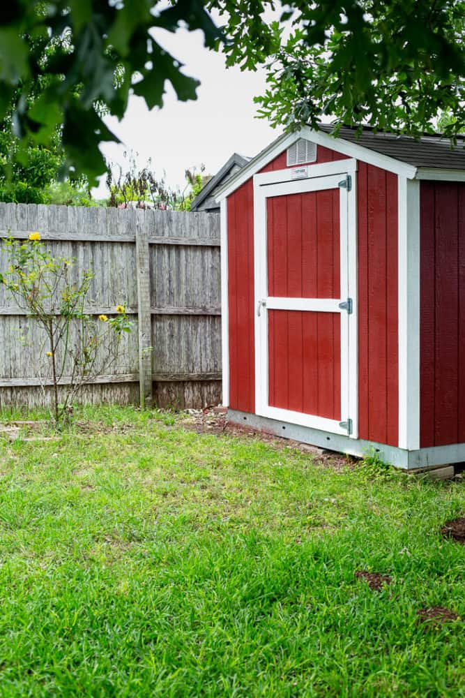 A backyard shed that has been painted red