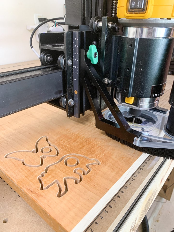 Close-up of X-Carve machine cutting out animal shapes for teethers