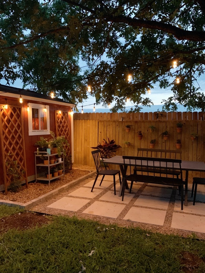 view of pea gravel patio at night