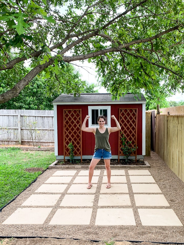 woman flexing on a DIY pea gravel patio