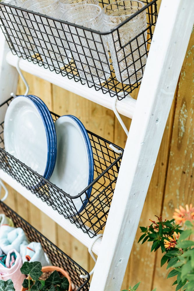 close up of DIY blanket ladder with wire baskets