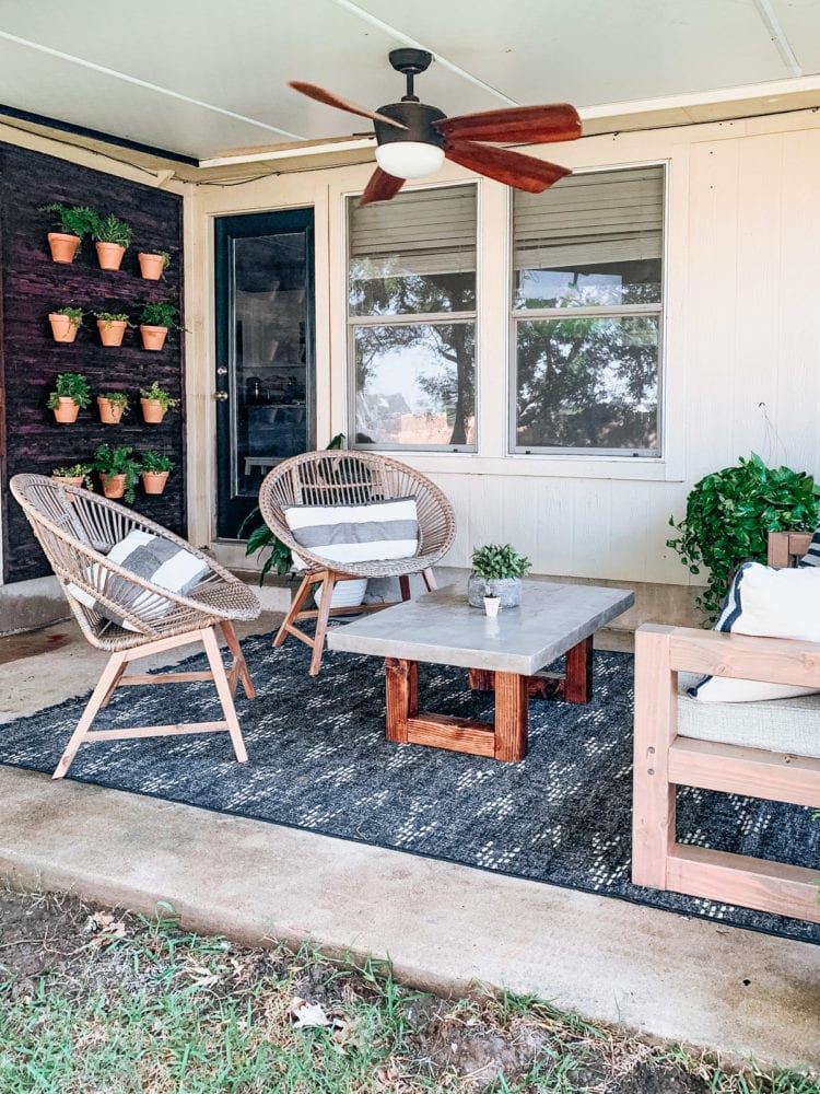 back porch with a plant wall to one side