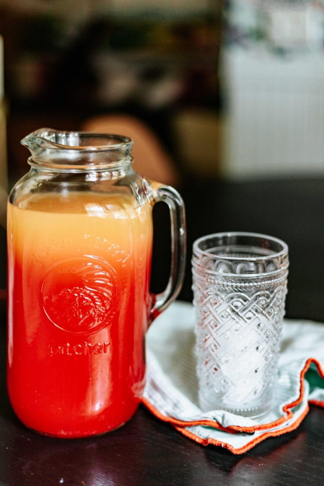 pitcher of a summer cocktail next to an empty glass