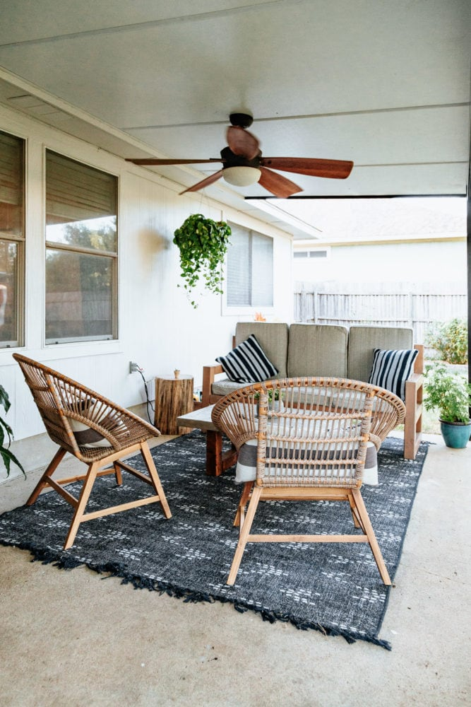 back patio with a couch and two lounge chairs