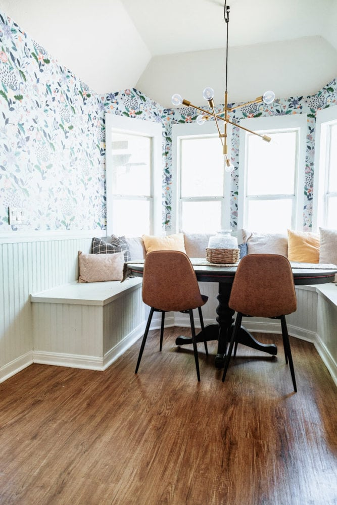 bright, colorful dining room nook with a DIY bay window bench