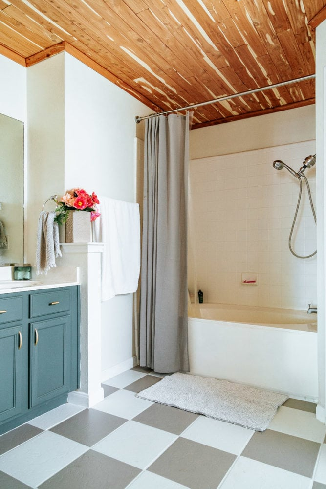 finished bathroom with painted tile floor