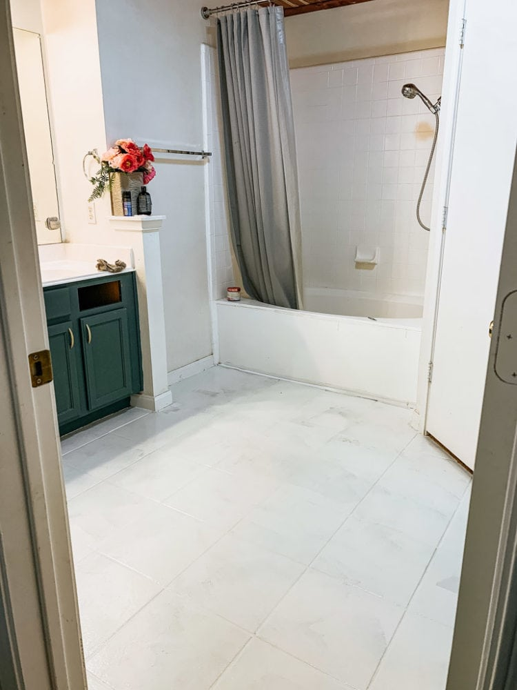 floor painted with one layer of Rust-Oleum's Rock Solid Home