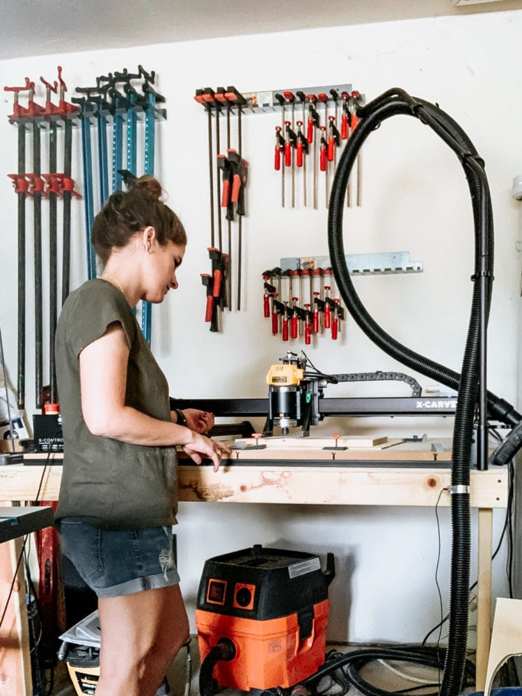 woman using an inventables x-carve machine