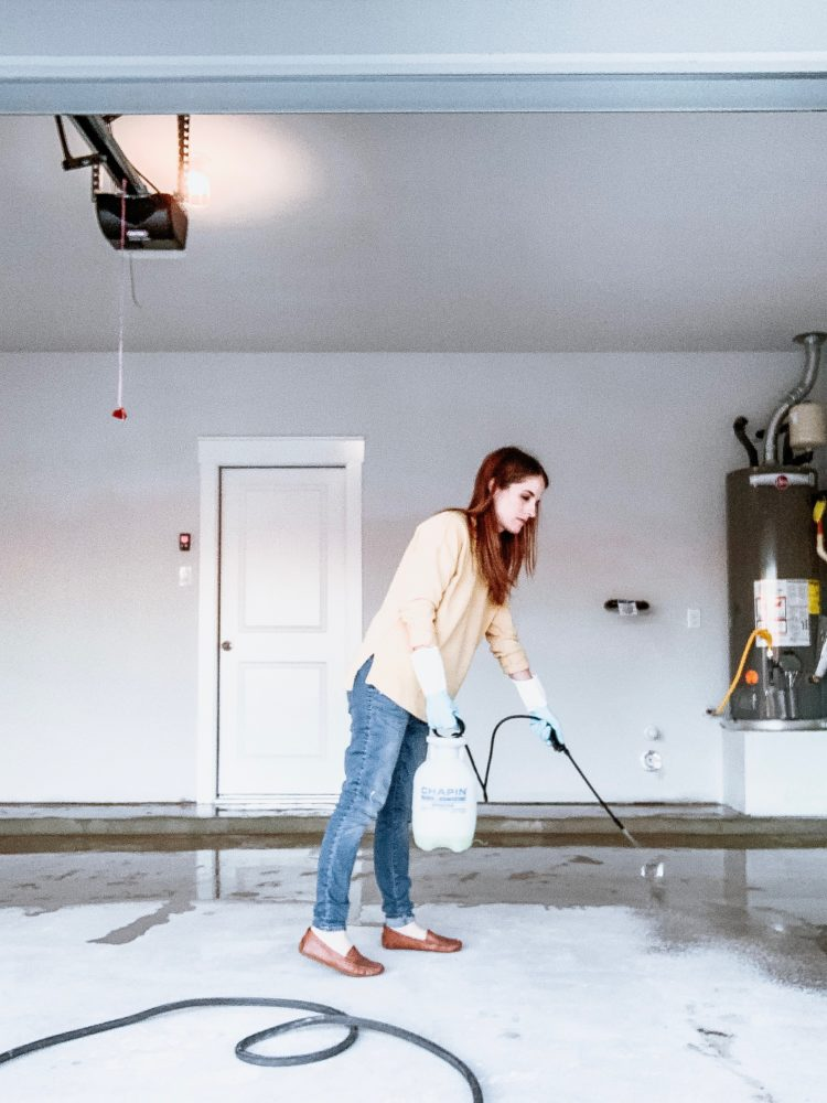 woman cleaning a garage floor