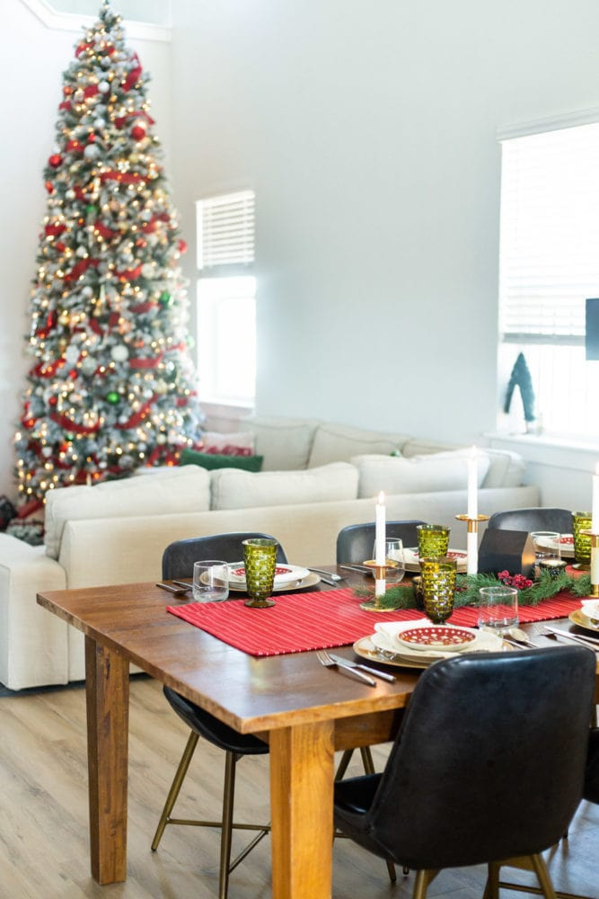 Christmas table scape with tree in the background