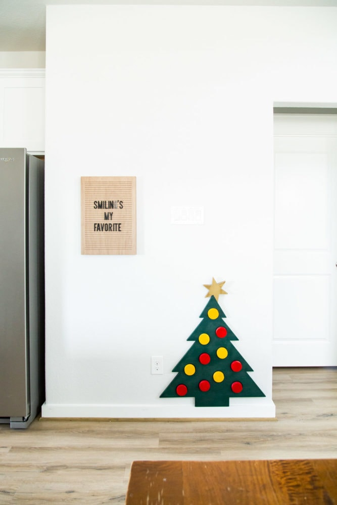 kitchen with a toy wooden Christmas tree