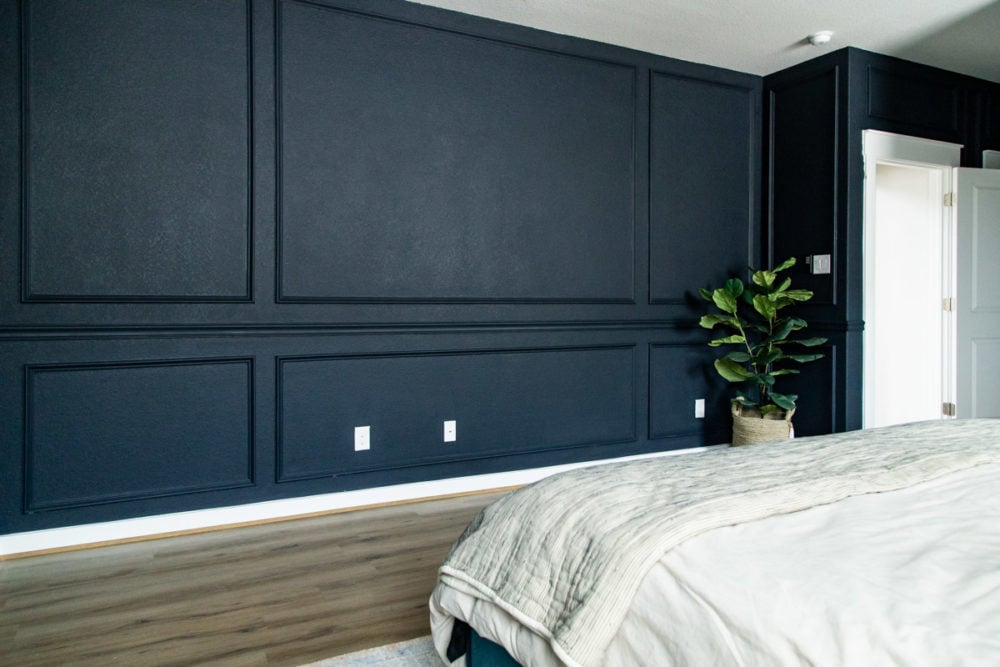 corner of room with DIY picture molding and chair rail