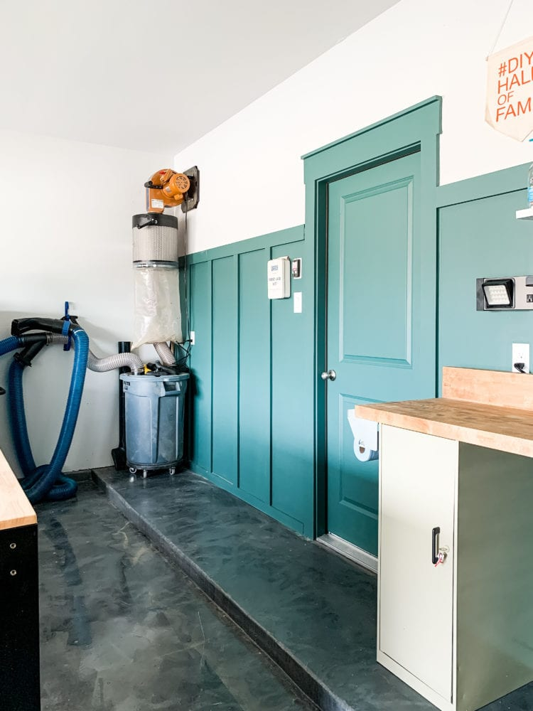 an organized garage with green board and batten