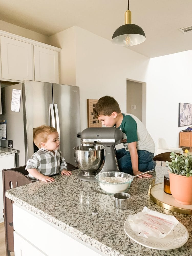 two young boys baking cookies