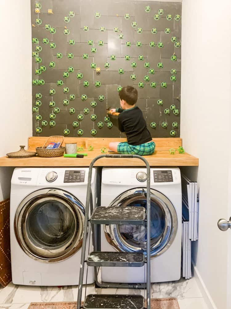 young boy knocking tile spacers out
