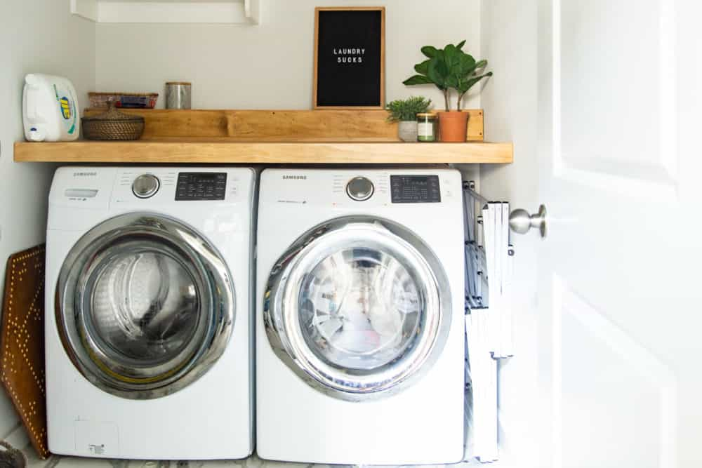 laundry room with side-by-side washer and dryer with a DIY wood countertop over them