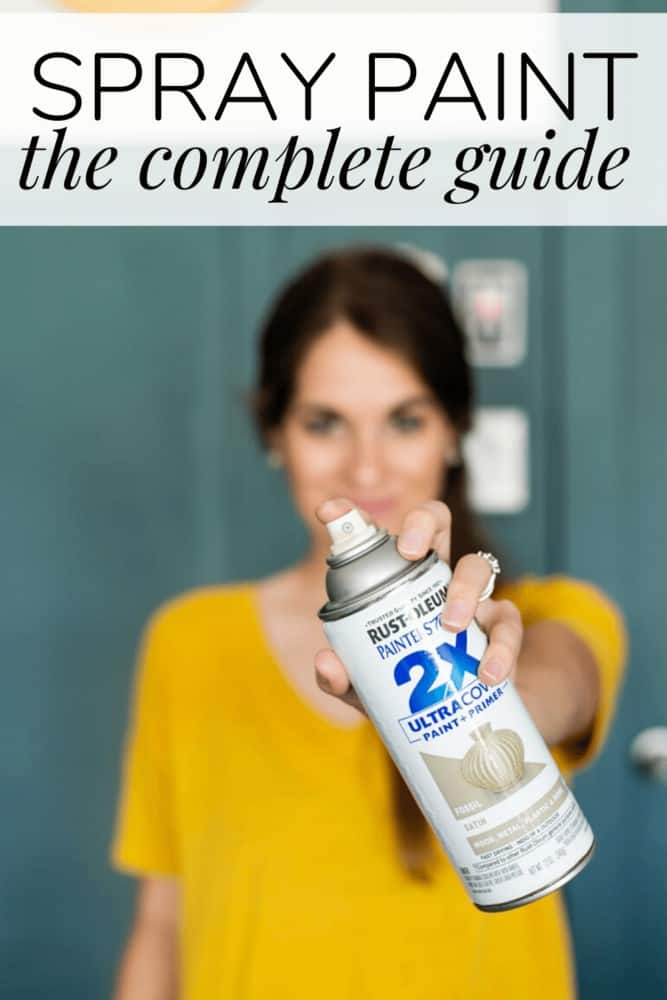 Woman holding up a can of spray paint, with text overlay - spray paint the complete guide