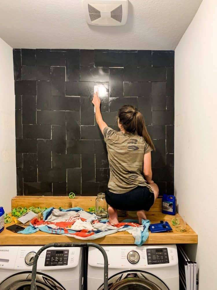 woman sealing tile with Miracle Sealants