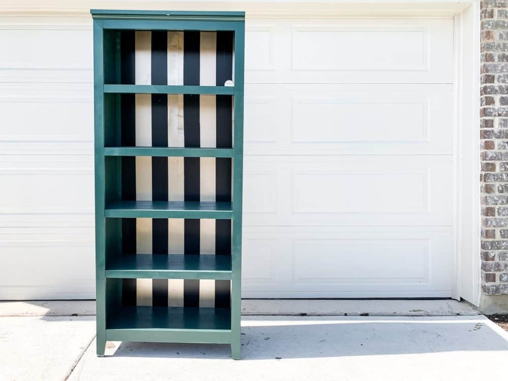A green and gold bookcase