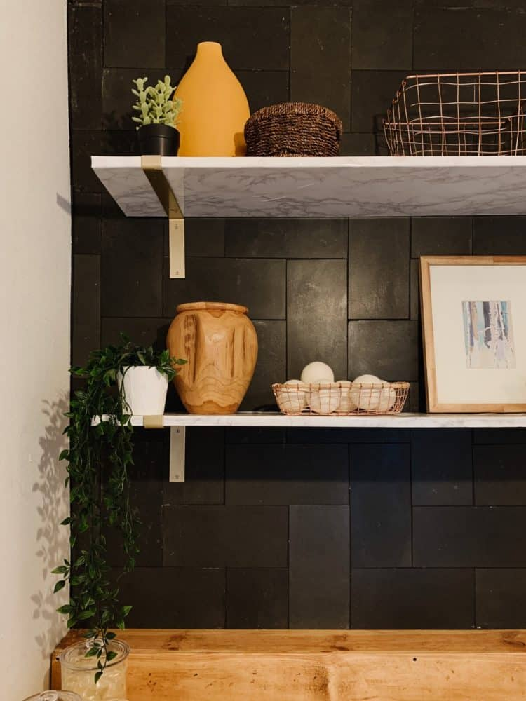 DIY faux marble shelving in a laundry room