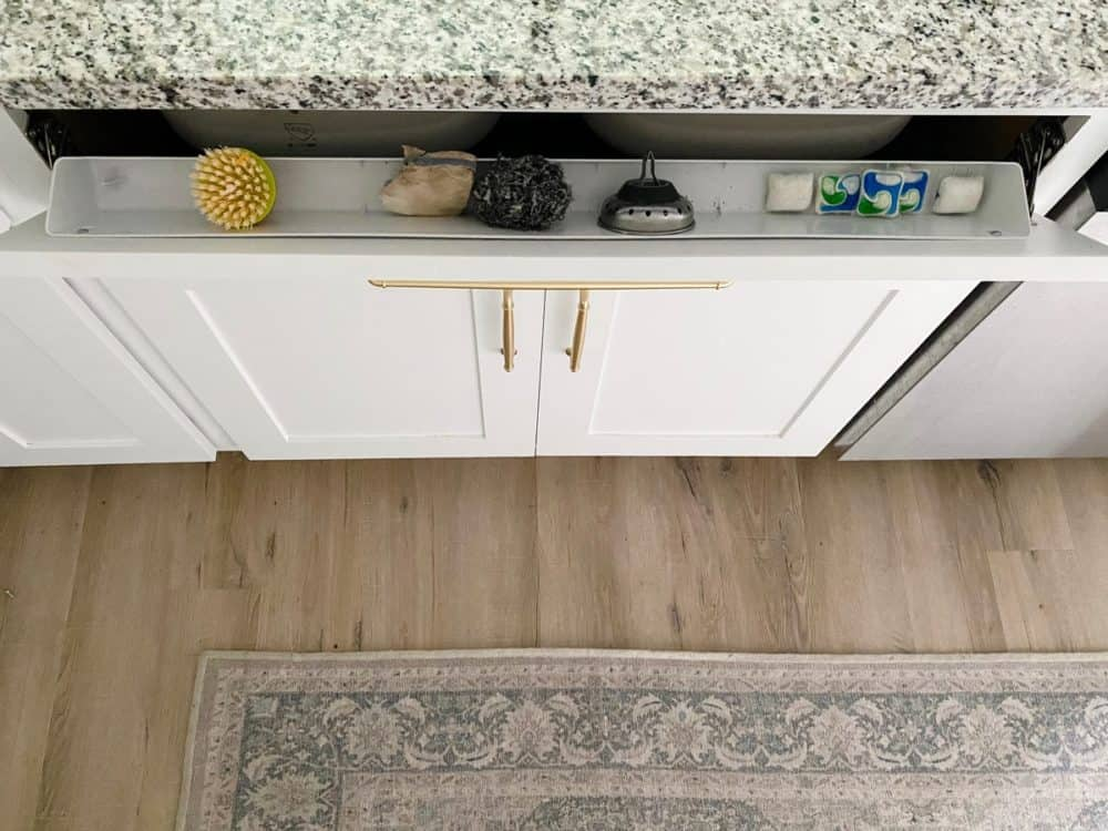 tilt-down drawer front at kitchen sink