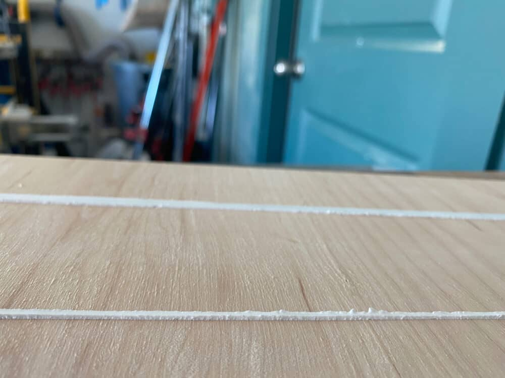 close up of a bead of caulk where tape was applied very close to the line