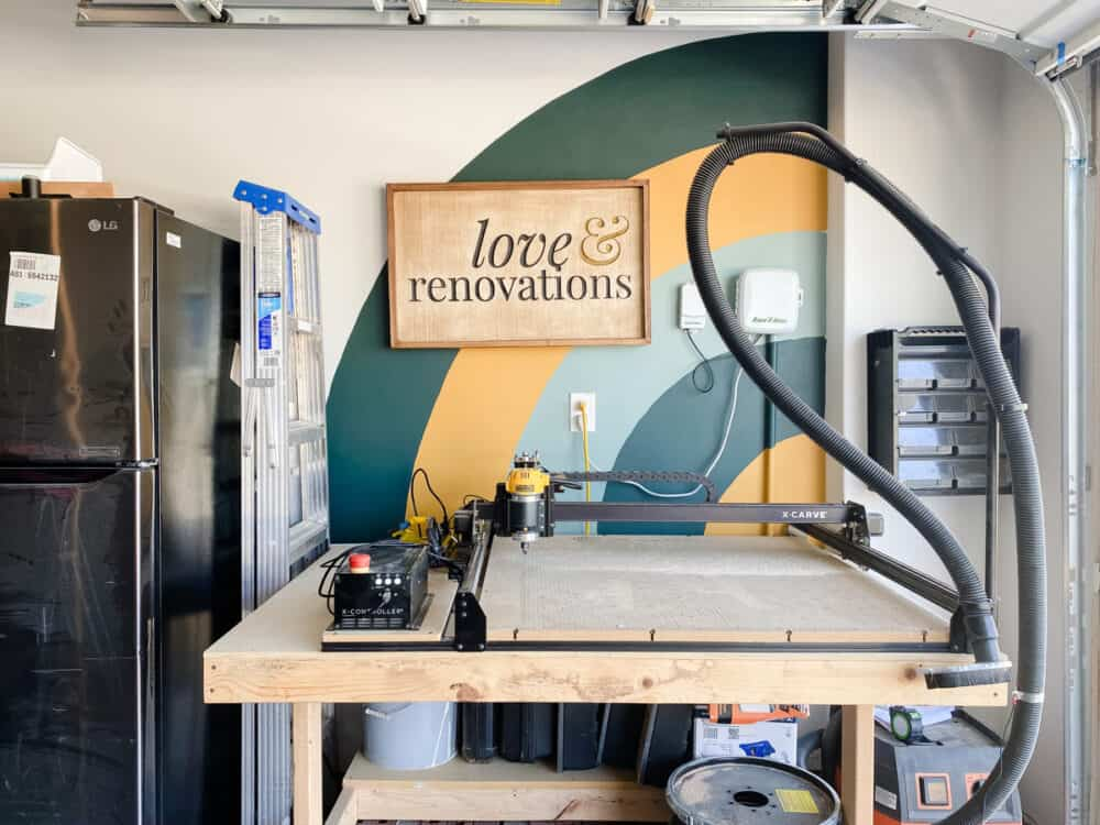 garage with an Inventables X-Carve, an arched mural, and a logo sign