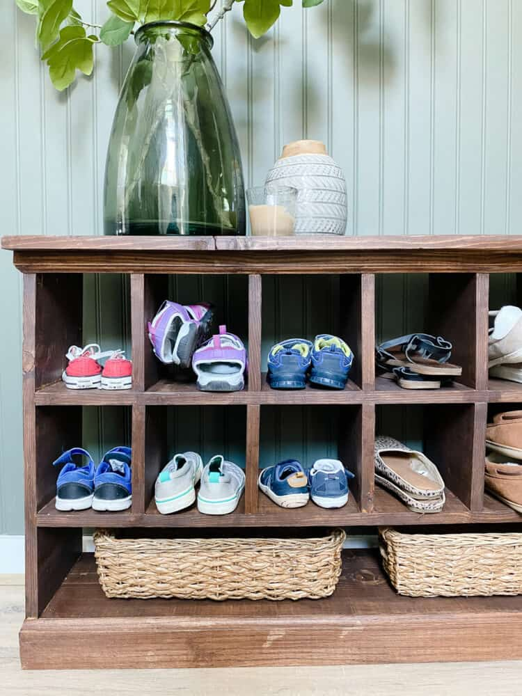 close up of shoe cubby with shoes in it