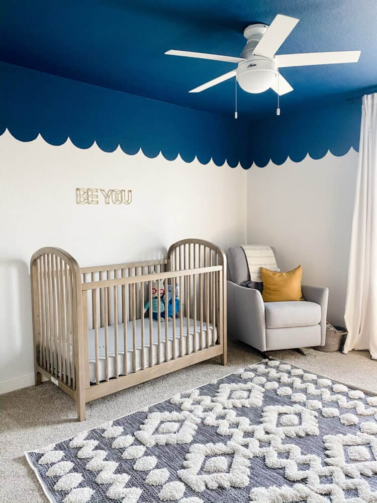 nursery with blue ceiling with scalloped edges