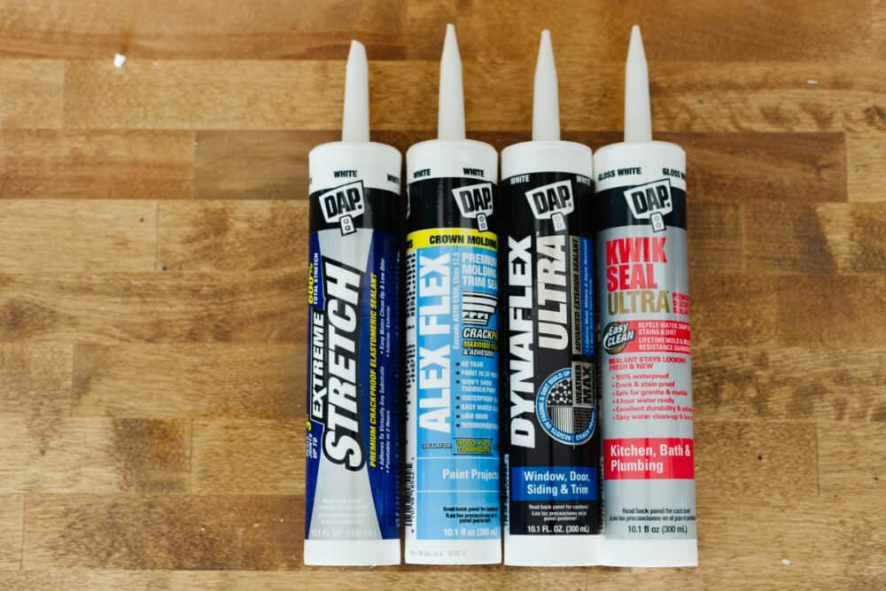 collection of four types of DAP brand caulk