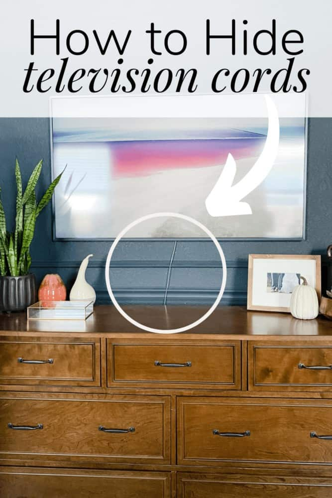 """a close up of a television hung above a dresser with a visible cord. There is a text overlay that states """"how to hide television cords"""""""
