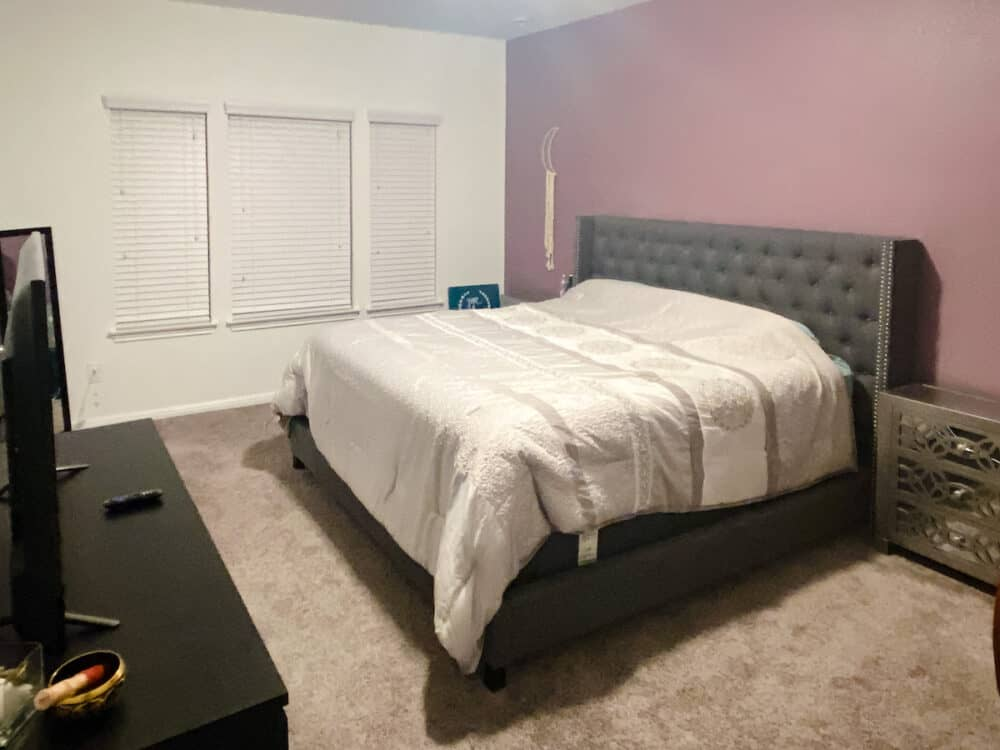 before of master bedroom with purple accent wall