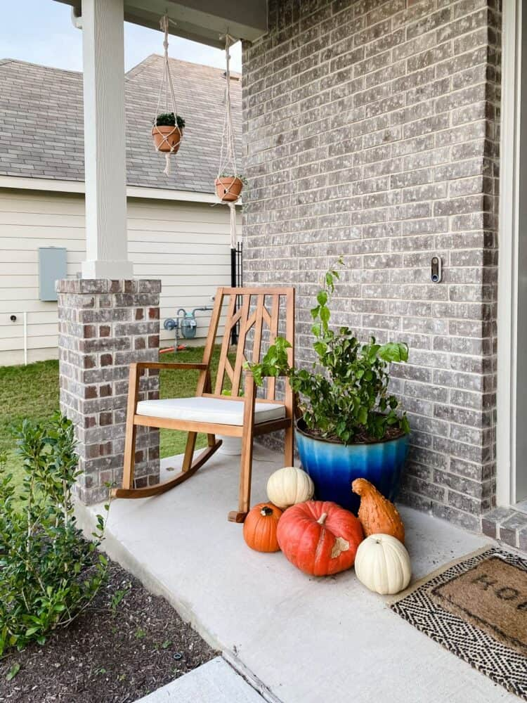 front porch with pumpkins and DIY macrame hanging planters
