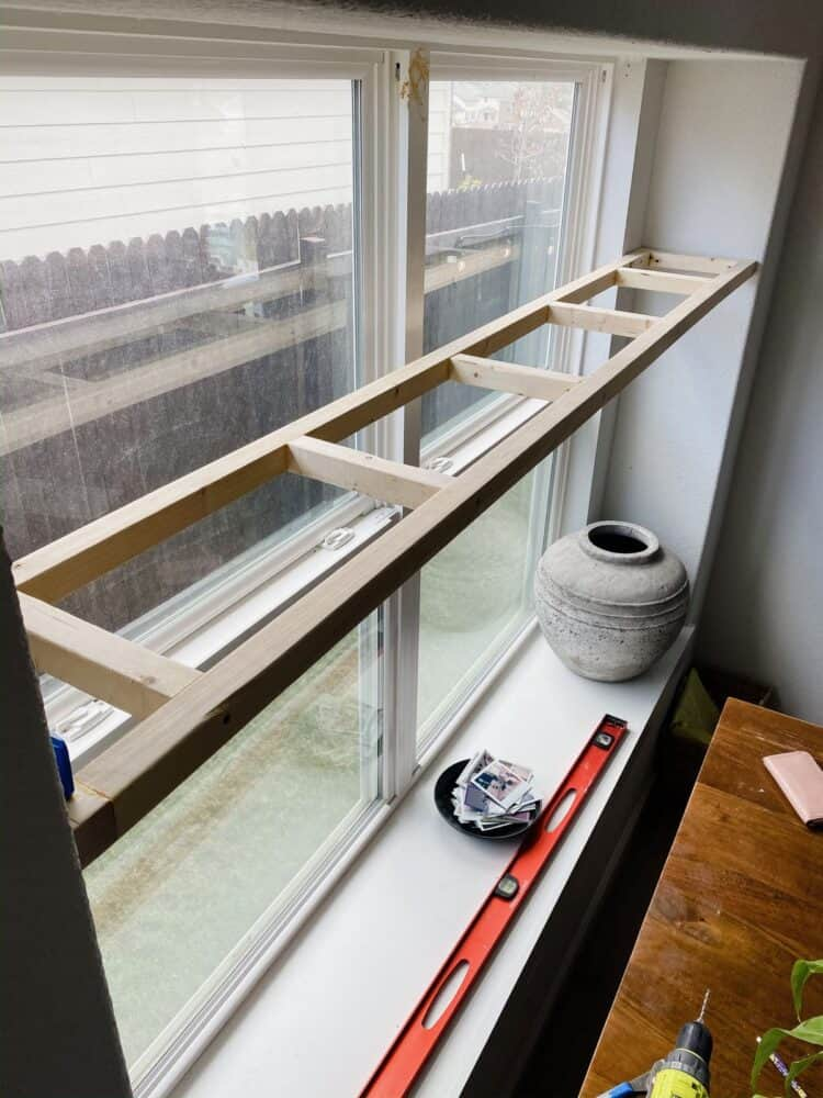 Framing for DIY plant shelf hung in a window