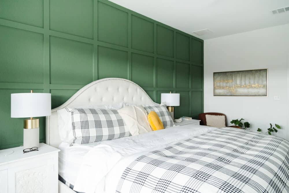 master bedroom with green accent wall and neutral furnishings