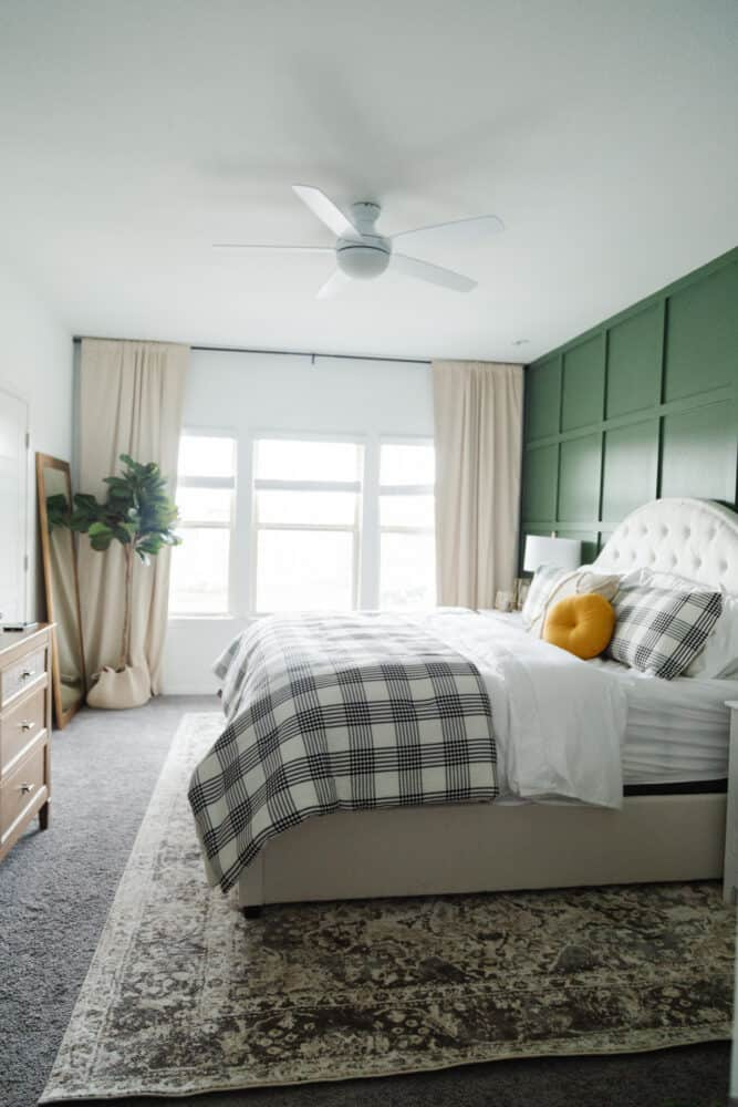a green and white master bedroom
