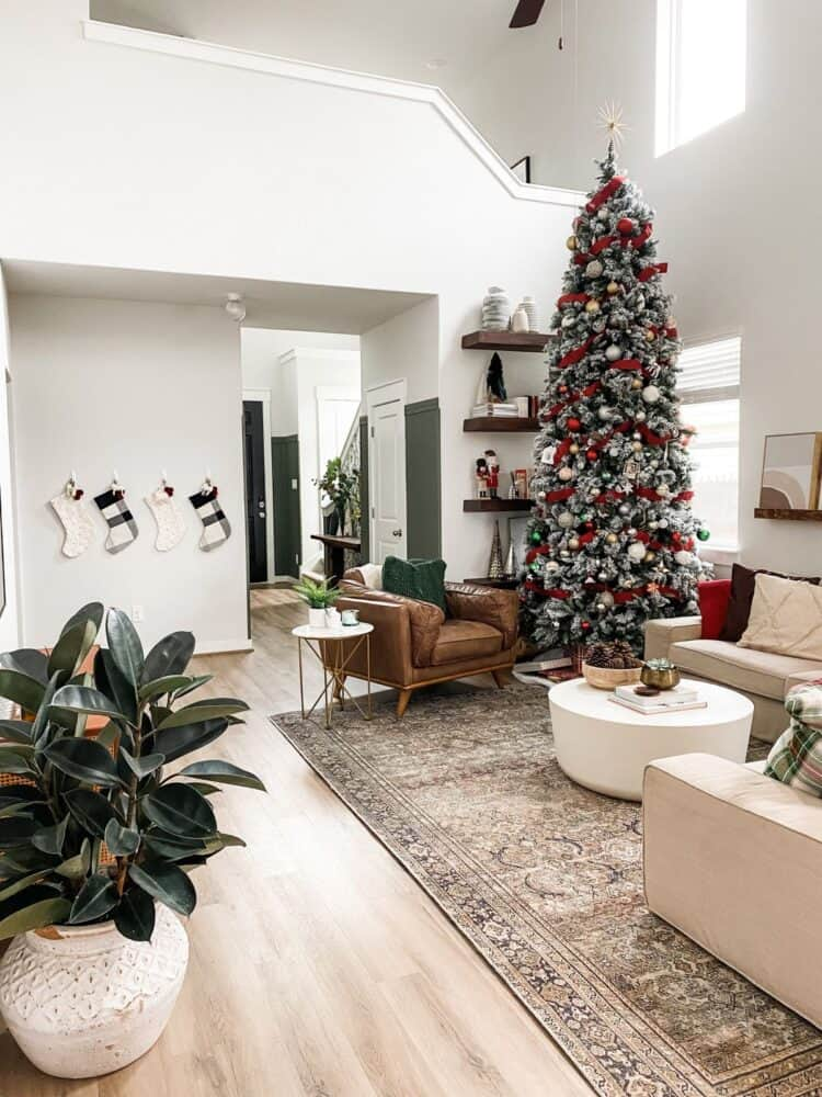 wide view of living room with 12-foot tall Christmas tree
