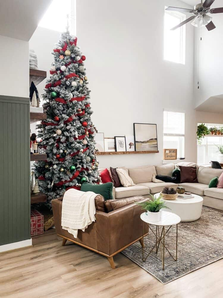 cozy and neutral living room with tall Christmas tree