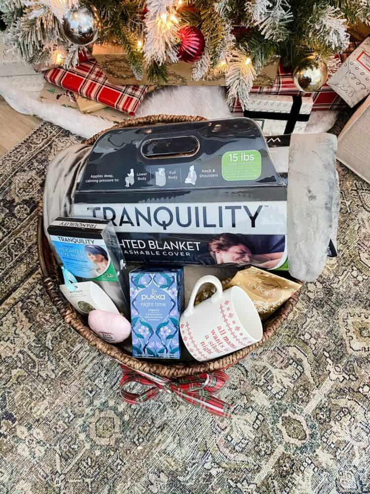 gift basket with weighted blanket and other relaxing items
