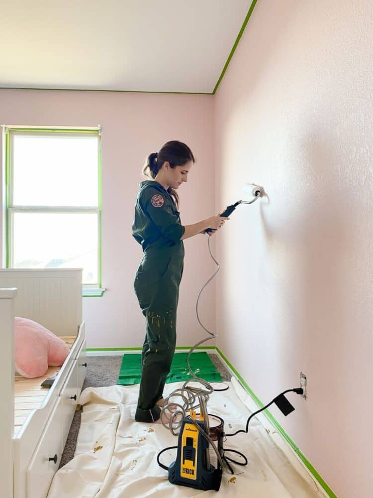 woman painting a room using Wagner's Sidekick Power Roller
