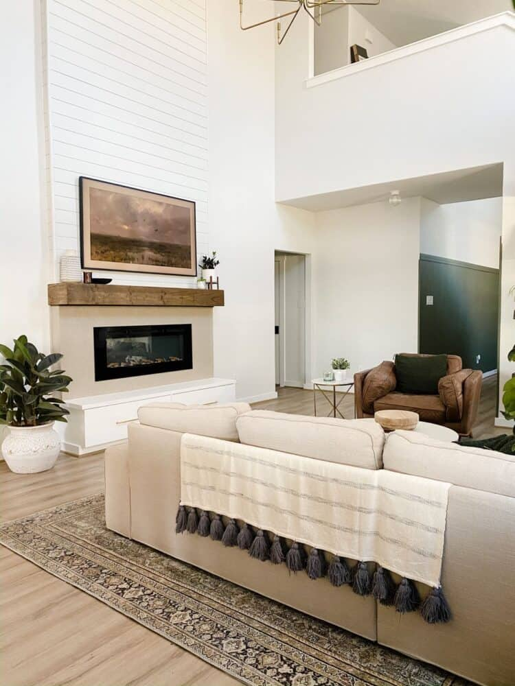 Living room with two-story fireplace