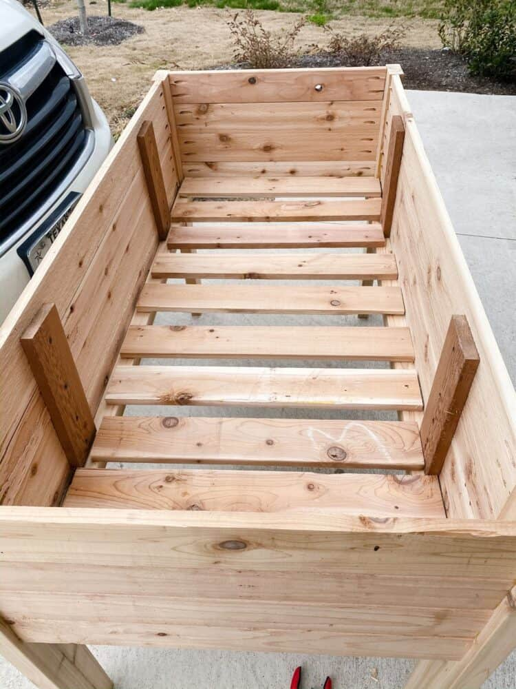 the bottom of a DIY raised planter bed