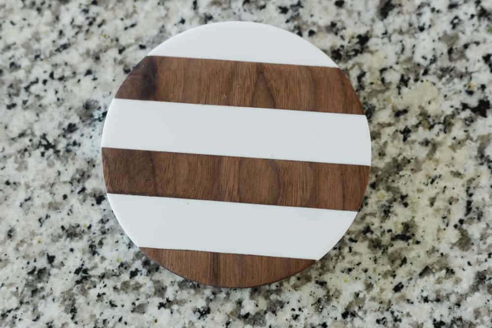 walnut and corian striped trivet carved using the Inventables X-Carve