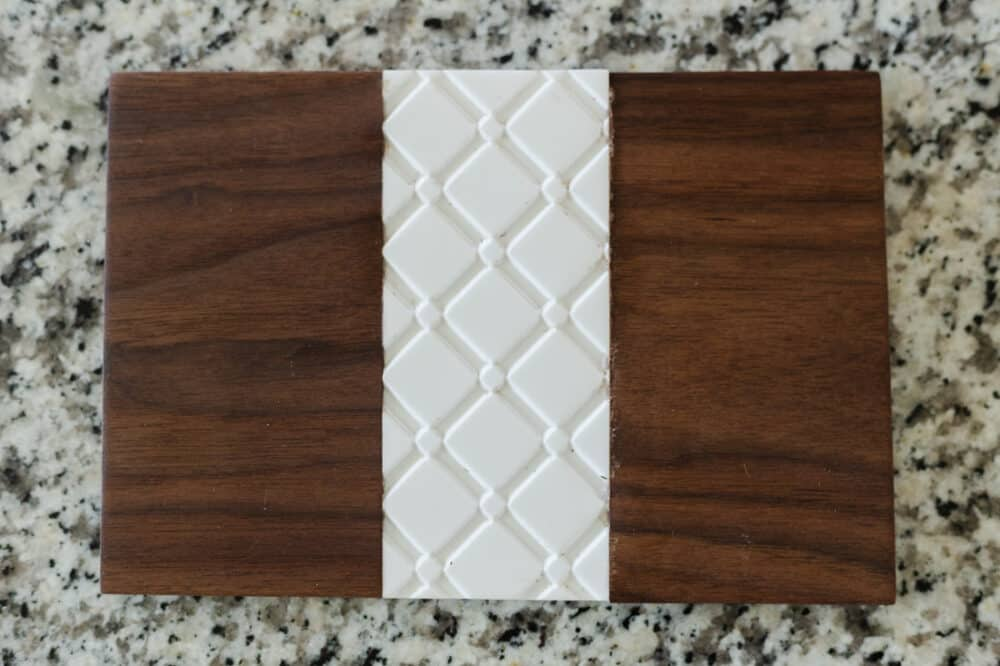Wood and corian trivet created using the X-Carve