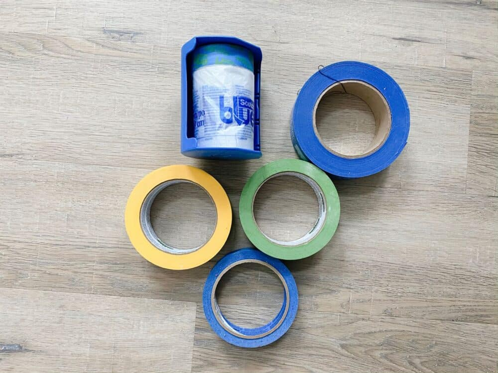 collection of painter's tape laying on wood floor